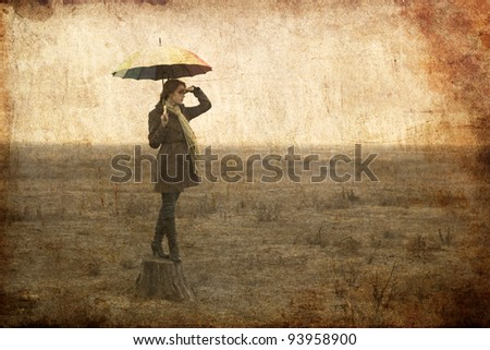 Redhead girl with umbrella at outdoor.