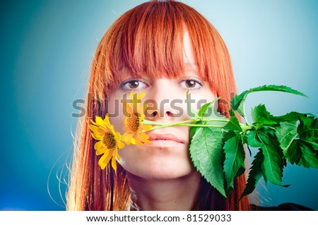 redhead girl with yellow flower - stock photo