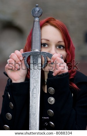 Redhead gothic girl with a ancient sword
