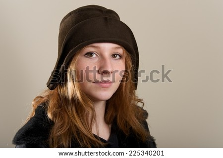 Redhead in brown cloche hat and jacket
