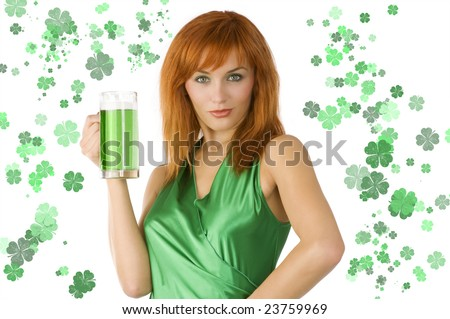 redhead Irish Lass posing in green dress with glass of green beer