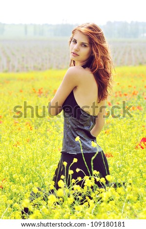 redhead  pretty girl in field -  vintage style - stock photo