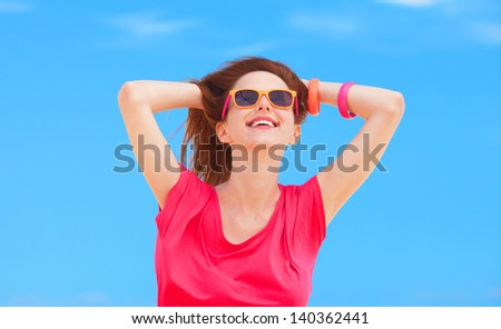 Redhead teen girl on blue sky background