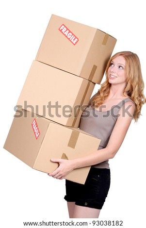 redhead woman carrying cartons - stock photo