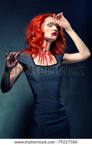 Redhead woman with blood in her face and neck