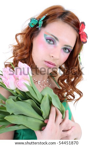 Redhead woman with bouquet of tulips