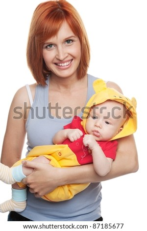 Redhead woman with child in funny costume. - stock photo