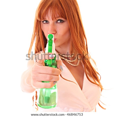 Redhead woman with spray  isolated on white - stock photo