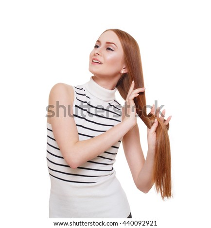 Redhead woman with strong healthy hair portrait. Young red ginger girl shows natural hair strength. Beautiful, stylish, attractive girl isolated at white background. Hair care, hairstyle. - stock photo