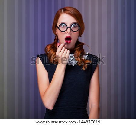 Redhead women with lipstick - stock photo