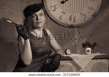 Redhead women with mouthpiece near the clock. Photo in old image style. Sepia. - stock photo