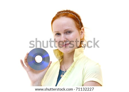 redhead young woman holding a CD in her hand