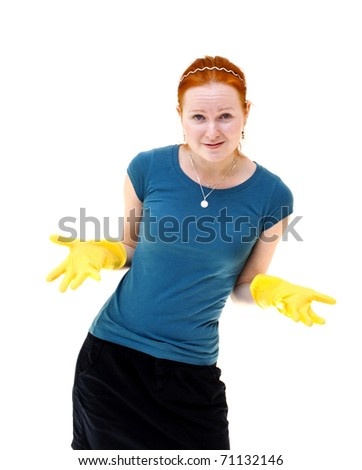 redhead young woman with yellow gloves as a housewife