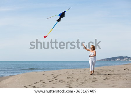 redheaded model holding kite and posing