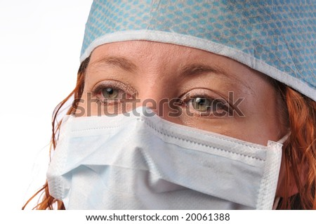 redheaded nurse or medical worker in a hat and mask