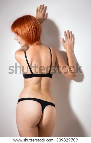 redheaded woman in lingerie - stock photo