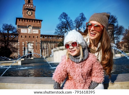 Rediscovering things everybody love in Milan. Portrait of smiling modern mother and daughter travellers in sunglasses in Milan, Italy looking into the distance