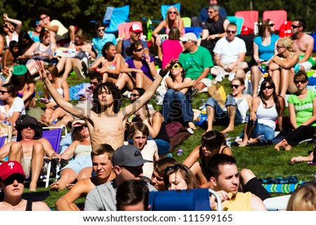 REDMOND, WA - AUGUST 25:  A sold out crowd with thousands of fans listening to music at the Summer End Camp at Marymoor Park in Redmond, WA on August 25, 2012. - stock photo