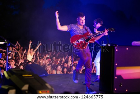 REDMOND, WA  - AUGUST 25, 2012:  Jack Antonoff of Indie rock band FUN performs on stage for the End Summer Camp at Marymoor Amphitheater in Redmond, WA on August 25,2012. - stock photo