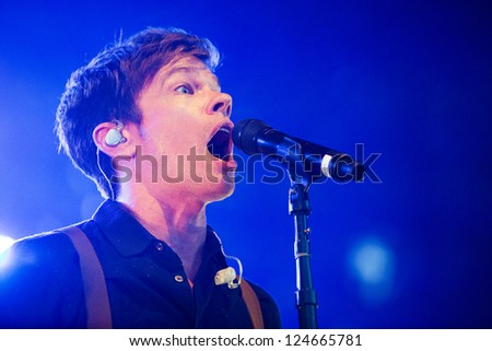 REDMOND, WA  - AUGUST 25, 2012:  Singer Nate Ruess of Indie rock band FUN performs on stage for the End Summer Camp at Marymoor Amphitheater in Redmond, WA on August 25,2012. - stock photo