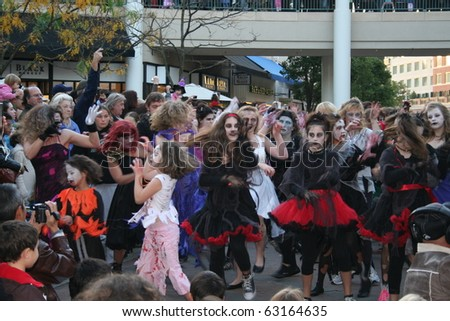 "REDMOND, WASHINGTON USA - OCT 25: unidentified Dancers dressed as zombies perform Oct 25 2009 in Redmond, Washington. Annually, dancers around the world perform a ""Thrill the World"" zombie dance. - stock photo"