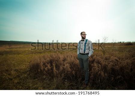 Redneck nerd man in glasses with beard outdoor - stock photo
