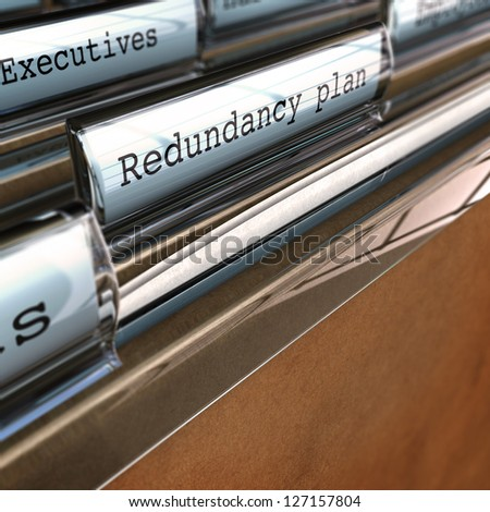 redundancy plan written on a folder with the word executives at the background, perspective view and blur effect