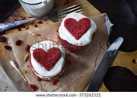 Redvelvet pie with cream cheese frosting and a red heart.Top view - stock photo