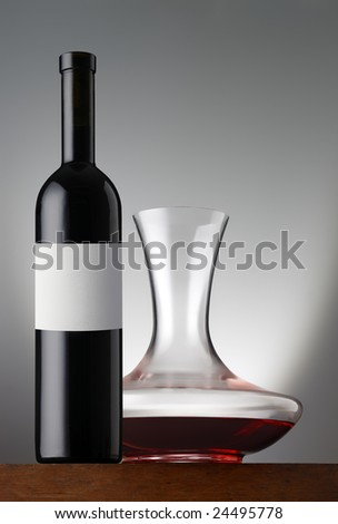 Redwine bottle with decanter - stock photo