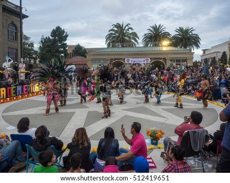 Redwood City, CA/USA - November 6, 2016: Dia de Los Muertos celebration to honor the dead with a parade and party in downtown Redwood City.