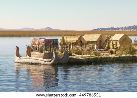 Reed boat on Island of Uros. Those are floating islands on lake Titicaca located between Peru and Bolivia. Colorful image with yellow boat and clear blue sky. - stock photo