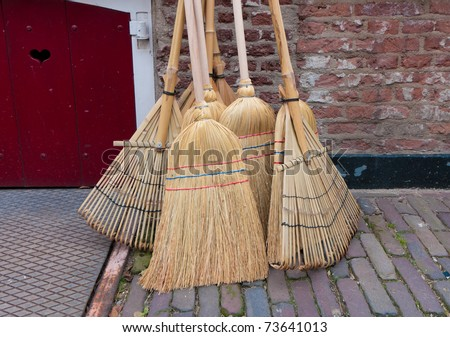 reed brooms for sale on a market in Deventer, Netherlands - stock photo