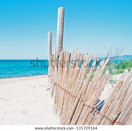 reed palisade in a Sardinia beach