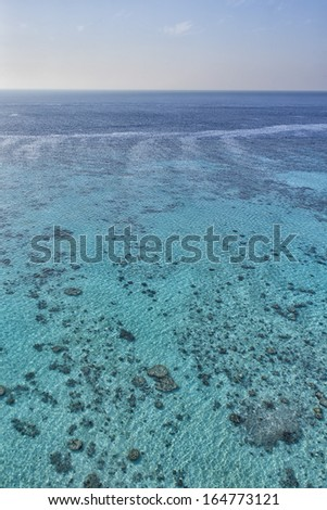 reef aerial view with turquoise clear water