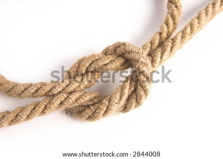 Reef or square knot over white background.