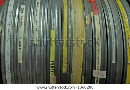 Reel cases - film reel metal cases with description tags on them - stock photo