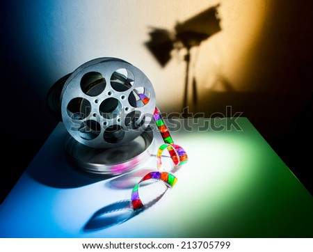 Reel of film on a wall background - stock photo
