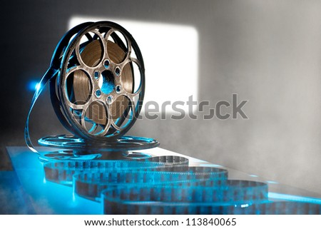 Reel of film on the background screen - stock photo