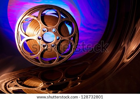Reel of film on the bright background - stock photo