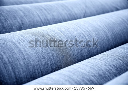 reel of jeans cloth stacked in the factory