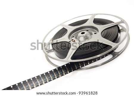 reel of 8mm motion picture film on white - stock photo