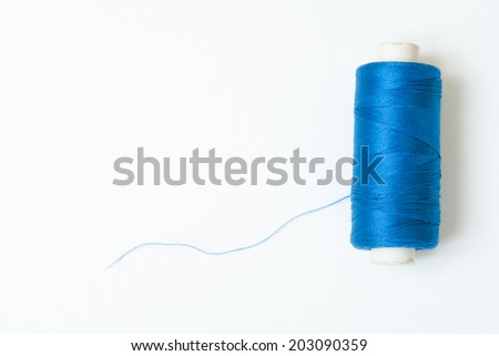 reel of thread on white, not isolated - stock photo