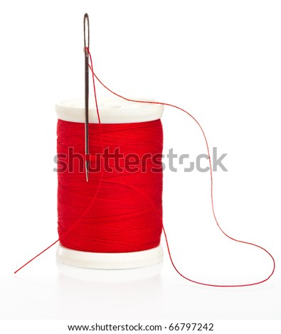 Reel with thread and needle on a white background - stock photo