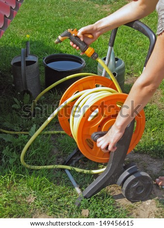 Reel with watering hose and the sprinkler