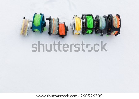 reels for fly fishing on a white background - stock photo