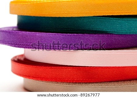 Reels of ribbon isolated on the white background - stock photo