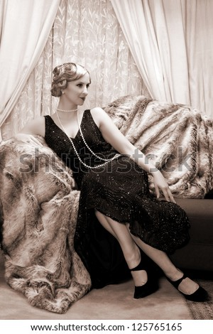 Reenactment of a vintage scene with a lady in the roaring twenties style - stock photo