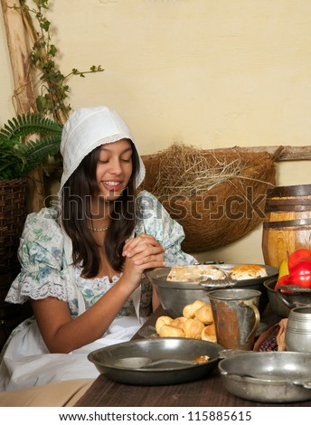 Reenactment scene of the first Thanksgiving Dinner in Plymouth in 1621 with a Pilgrim family - stock photo