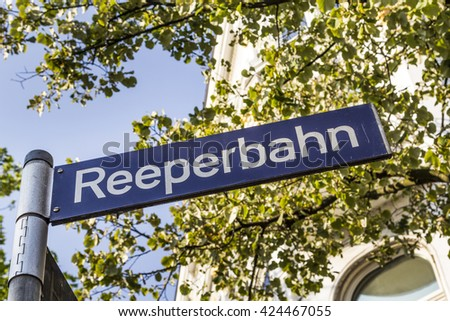 reeperbahn street sign in Hamburg with tree as background - stock photo