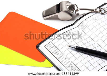 Referee cards, whistle, notebook and pen, isolated on white background - stock photo